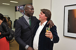 Left to right, OZWALD BOATENG and BEN BROWN at a private view of Alison Jackson's photographs 'Up The Aisle' held at the Ben Brown gallery 12 Brook's Mews, London W1 on 19th April 2011.