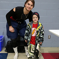 WELLINGTON, ON - FEBRUARY 10: Tanner Beals #1 of the Wellington Dukes meets a young fan on February 10, 2019 at Wellington and District Community Centre in Wellington, Ontario, Canada.<br /> (Photo by Ed McPherson / OJHL Images)