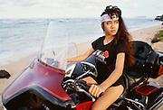Polynesian girl on motorcycle, Oahu, Hawaii