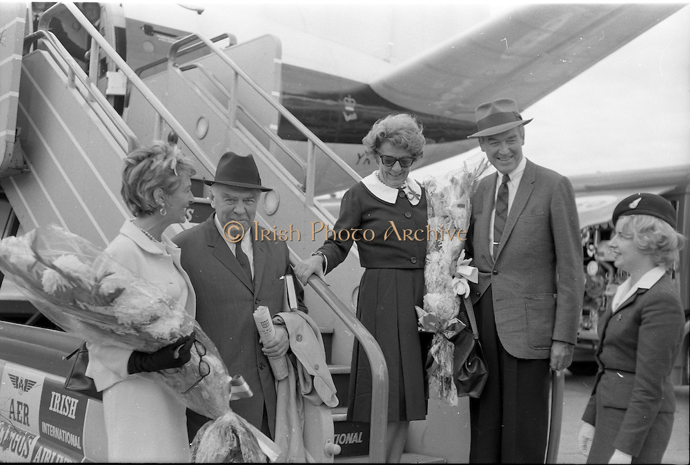 31/07/1962<br /> 07/31/1962<br /> 31 July 1962<br /> Arrival of Mr F. Kirk Johnston, Chairman, Ambassador Oil Corporation and President of Ambassador Irish Oil Company and James Stewart actor and Ambassador shareholder, at Dublin Airport. Aer Lingus hostess on right.