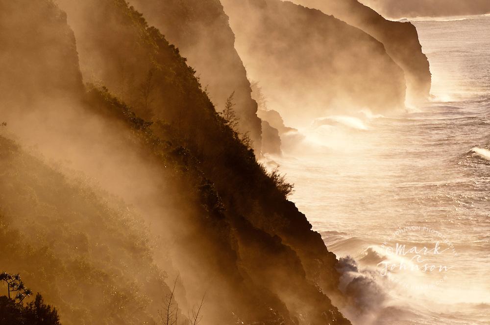The Na Pali coast shrouded in salt spray from winter surf, Kauai, Hawaii