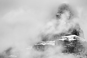 Castle Mountain peak in fog. Icefields Parkway.<br />