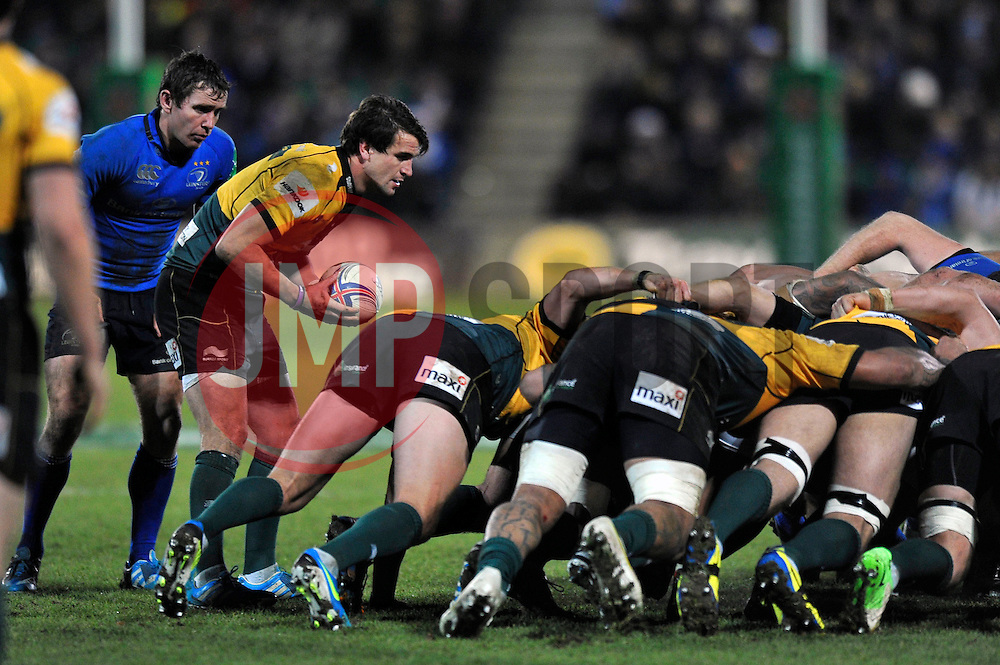 Lee Dickson (Northampton) looks to put the ball into a scrum - Photo mandatory by-line: Patrick Khachfe/JMP - Tel: Mobile: 07966 386802 07/12/2013 - SPORT - RUGBY UNION -  Franklin's Gardens, Northampton - Northampton Saints v Leinster - Heineken Cup.
