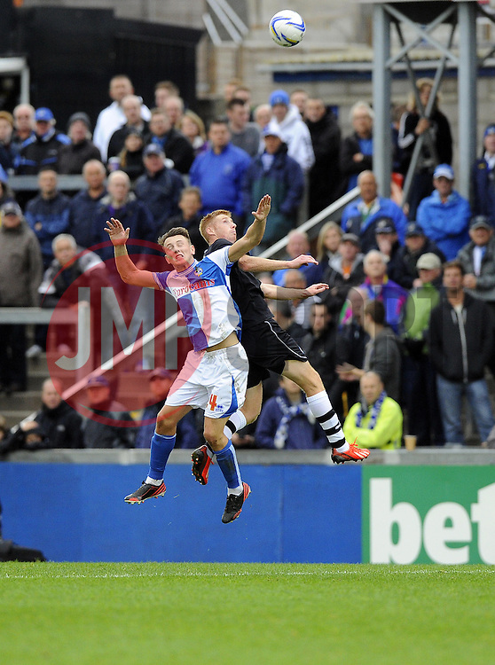 Bristol Rovers' Ollie Clarke battles for the high ball with Chesterfield's Eoin Doyle - Photo mandatory by-line: Joe Meredith/JMP - Tel: Mobile: 07966 386802 26/10/2013 - SPORT - FOOTBALL - Memorial stadium - Bristol - Bristol Rovers v Chesterfield United - League Two