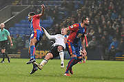 Bolton Wanderers Midfielder, Josh Vela (6) tackled  during the The FA Cup 3rd round match between Bolton Wanderers and Crystal Palace at the Macron Stadium, Bolton, England on 7 January 2017. Photo by Mark Pollitt.