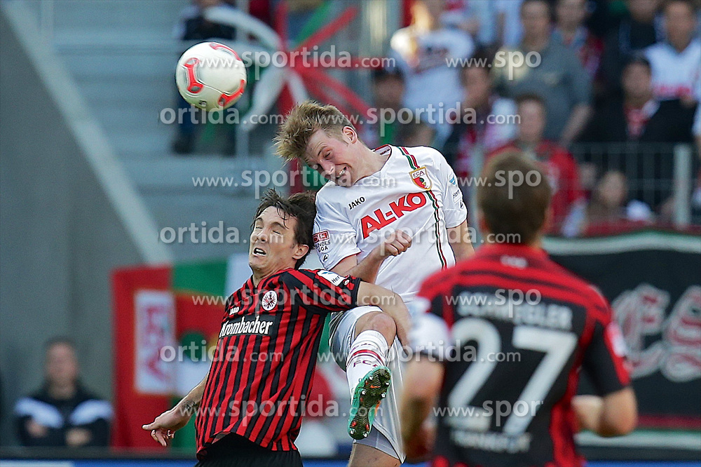 14.04.2013, SGL Arena, Augsburg, GER, 1. FBL, FC Augsburg vs Eintracht Frankfurt, 29. Runde, im Bild Kopfballduell zwischen Srdjan LAKIC (# 11, Eintracht Frankfurt) und Jan-Ingwer CALLSEN-BRACKER (# 18, FC Augsburg) v.l // during the German Bundesliga 29th round match between FC Augsburg and Eintracht Frankfurt at the SGL Arena, Augsburg, Germany on 2013/04/14. EXPA Pictures © 2013, PhotoCredit: EXPA/ Eibner/ Peter Fast..***** ATTENTION - OUT OF GER *****