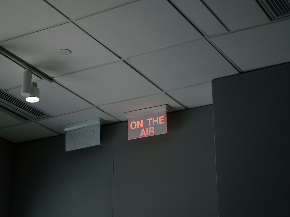 "An ""On The Air"" light signals that the Diane Rehm show is broadcasting from the WAMU studios in Washington D.C."