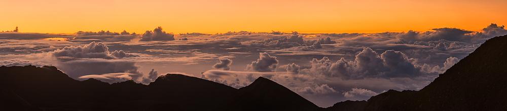 Panorama of Clouds at sunrsie from the summit of Haleakala, Haleakala National Park, Maui, Hawaii