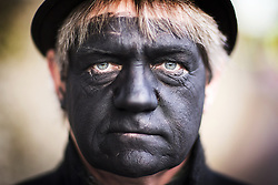 January 14, 2017 - Whittlesey, Cambridgshire, UK - Whittlesey UK. Picture shows a member of the Old Glory Molly dancers at the 38th Whittlesey Straw Bear Festival this weekend. In times past when starvation bit deep the ploughmen of the area where drawn to towns like Whittlesey, They knocked on doors begging for food & disguised their shame by blackening their faces with soot. In Whittlesey it was the custom on the Tuesday following Plough Monday to dress one of the confraternity of the plough in straw and call him a Straw Bear. The bear was then taken around town to entertain the folk who on the previous day had subscribed to the rustics, a spread of beer, tobacco & beef. The bear was made to dance in front of houses & gifts of money, beer & food was expected. (Credit Image: © Andrew Mccaren/London News Pictures via ZUMA Wire)