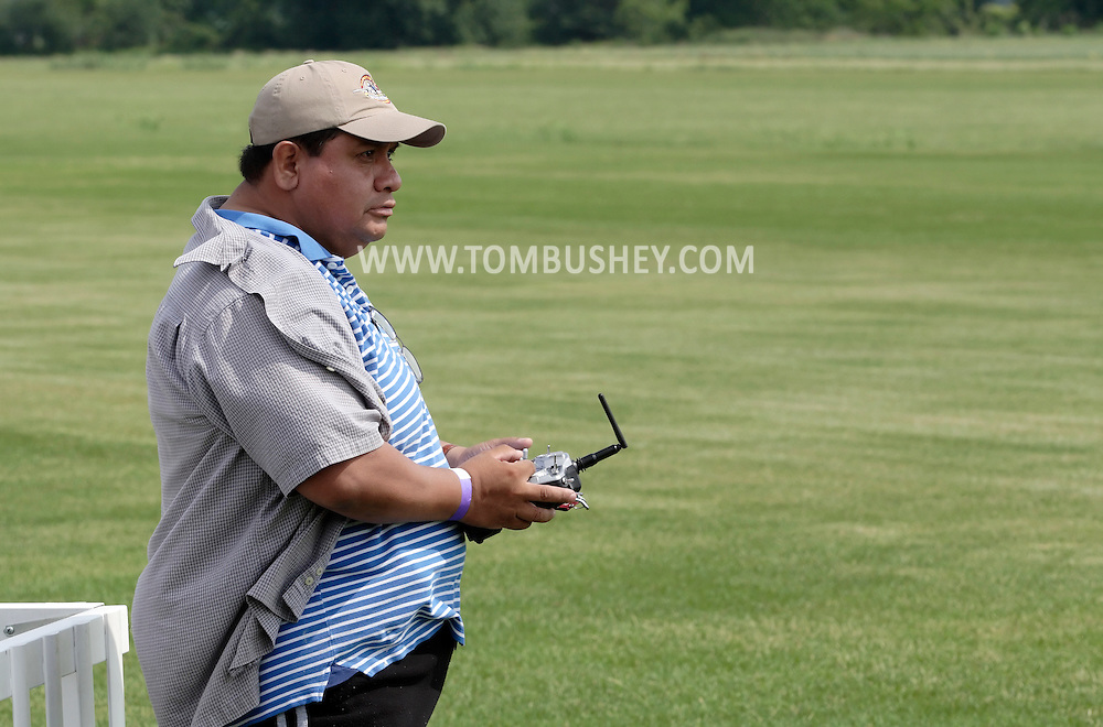New Hampton, New York - A man flies a remote controlled airplane at a fly-in sponsored by the Wawayanda Flying Club on June 5, 2010.