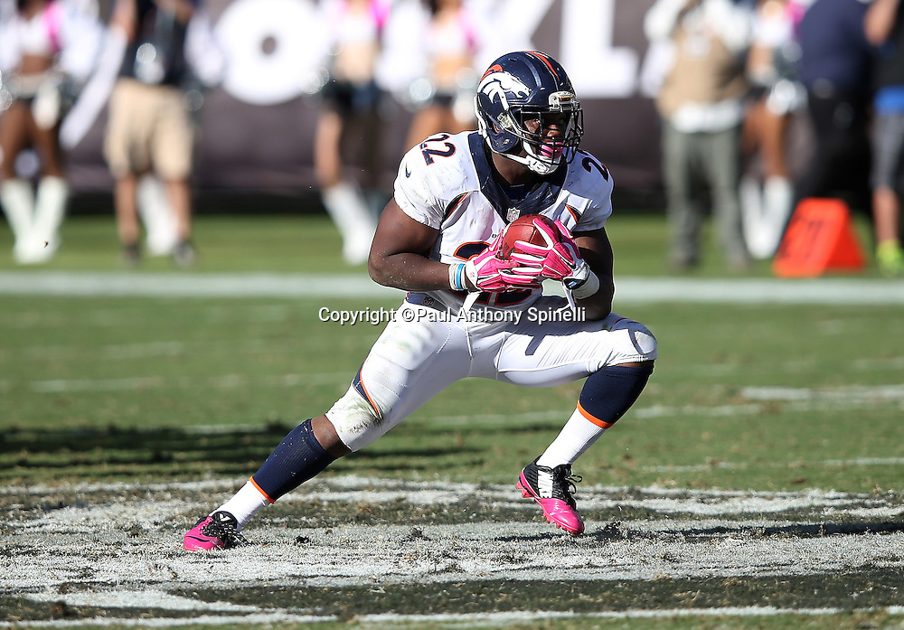 Denver Broncos running back C.J. Anderson (22) makes a cut after catching a first down pass on third down with 11 yards to go in the fourth quarter during the 2015 NFL week 5 regular season football game against the Oakland Raiders on Sunday, Oct. 11, 2015 in Oakland, Calif. The Broncos won the game 16-10. (©Paul Anthony Spinelli)