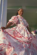 Euridice Scharbaai modeling traditional special occaision dress designed by her mother Marlene Scharbaai; Willemstad, Curacao, Netherlands Antilles.