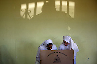 A nun helps a fellow sister cast her vote at the Lomas Del Guijarro building in Tegucigalpa, Sunday, Nov. 29, 2009. After months of turmoil following the Coup of former President Manuel Zelaya Honduras finally gets its chance to vote for the general elections that many hope will put the previous months behind them and return to normal.   Darren Hauck For The New York Times