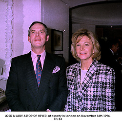LORD & LADY ASTOR OF HEVER, at a party in London on November 14th 1996..LTL 24