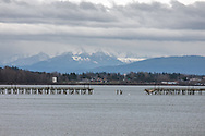 The destroyed section of the White Rock Pier after a December 20, 2018 storm.  A dock at the far end of the pier dislodged (with sailboats still attached) and ran into the pier destroying this section and damaging much of the remainder.  Photographed from the promenade at White Rock Beach in White Rock, British Columbia, Canada.