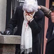 NLD/Rotterdam/20180220 - Herdenkingsdienst Ruud Lubbers, vrouw met bloedneus