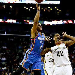 Feb 25, 2016; New Orleans, LA, USA; Oklahoma City Thunder guard Russell Westbrook (0) is fouled as he shoots over New Orleans Pelicans center Alexis Ajinca (42) during the first quarter of a game at Smoothie King Center. Mandatory Credit: Derick E. Hingle-USA TODAY Sports