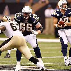 August 27, 2010; New Orleans, LA, USA; San Diego Chargers offensive tackle Jeromey Clary (66) blocks against New Orleans Saints defensive end Junior Galette (67) during the first half of a preseason game at the Louisiana Superdome. The New Orleans Saints defeated the San Diego Chargers 36-21. Mandatory Credit: Derick E. Hingle