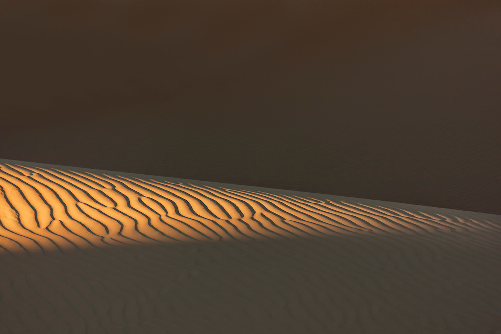 Sand pattern with deep shadows in the Sahara desert of Morocco.