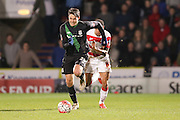 Stoke City defender Philipp Wollscheid  gets away from Doncaster Rovers forward Nathan Tyson  during the The FA Cup third round match between Doncaster Rovers and Stoke City at the Keepmoat Stadium, Doncaster, England on 9 January 2016. Photo by Simon Davies.