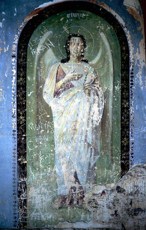 Defaced fresco of the Angel Gabriel in the ruins of a Greek Orthodox church in Ayvalik, Turkey