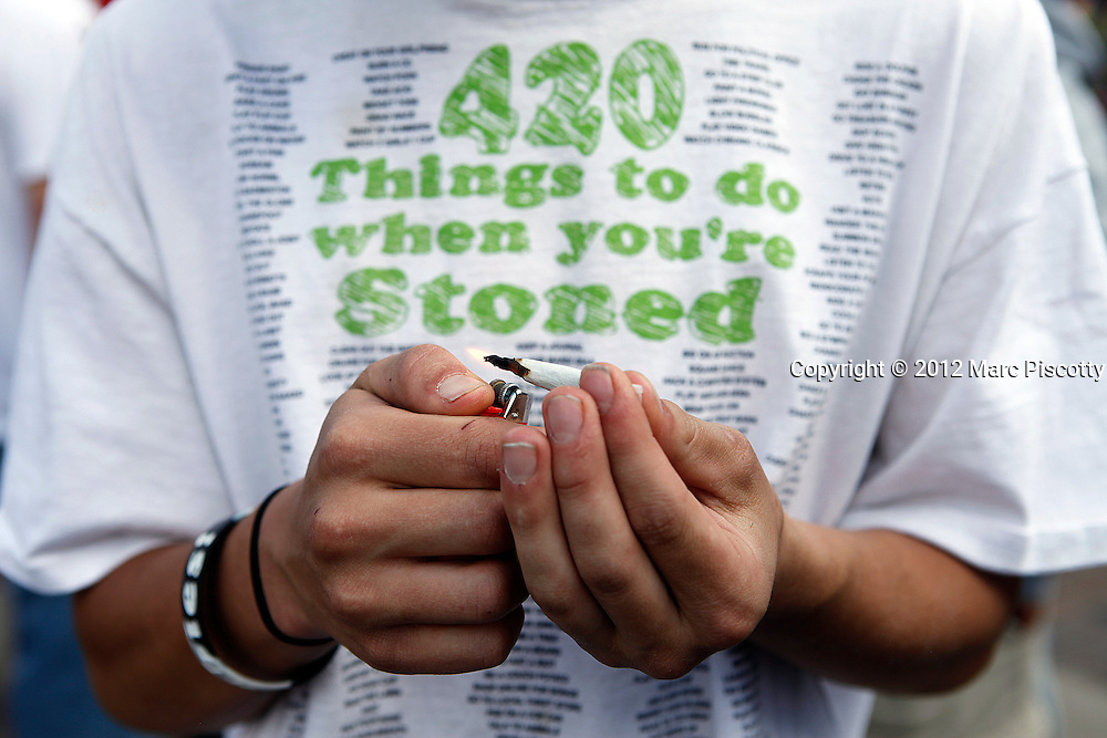 DENVER, CO - APRIL 20: Tyler Shumway of Aurora, Co. lights up a joint as an estimated 10,000 people gathered in Civic Center Park in Denver, Colorado on April 20, 2012 to celebrate the state's Medicinal Marijuana laws and collectively light up at 4:20pm. On Nov. 6, Colorado may become the first state to legalize marijuana with the passing of Amendment 64, a controversial ballot initiative that would permit up to 1 ounce of possession for those 21 and older. (Photo by Marc Piscotty/ © 2012)