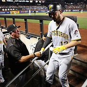 NEW YORK, NEW YORK - June 16:  Manager Clint Hurdle #13 of the Pittsburgh Pirates congratulates Matt Joyce #17 of the Pittsburgh Pirates as he returns to the dugout after hitting a home run during the Pittsburgh Pirates Vs New York Mets regular season MLB game at Citi Field on June 16, 2016 in New York City. (Photo by Tim Clayton/Corbis via Getty Images)