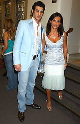 JOHN KRASNER and his mother ELLA KRASNER at a charity event 'In The Pink' a night of music and fashion in aid of the Breast Cancer Haven in association with fashion designer Catherine Walker held at the Cadogan Hall, Sloane Terrace, London on 20th June 2005.<br />