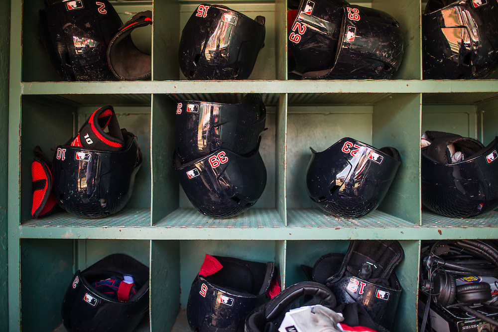 BOSTON, MA - JUNE 09:  A general view of the Boston Red Sox helmets in the dugout during the game between the Boston Red Sox and the Los Angeles Angels at Fenway Park in Boston, Massachusetts on June 9, 2013. (Photo by Rob Tringali) *** Local Caption ***