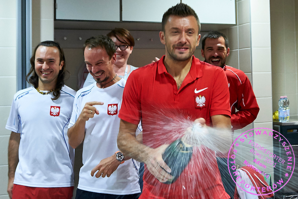 Michal Przysiezny of Poland sprays champagne during Davis Cup Tie World Group Play-off Poland v Slovakia at Gdynia Arena Hall in Gdynia, Poland.<br /> <br /> Poland, Gdynia, September 20, 2015<br /> <br /> Picture also available in RAW (NEF) or TIFF format on special request.<br /> <br /> For editorial use only. Any commercial or promotional use requires permission.<br /> <br /> Adam Nurkiewicz declares that he has no rights to the image of people at the photographs of his authorship.<br /> <br /> Mandatory credit:<br /> Photo by &copy; Adam Nurkiewicz / Mediasport