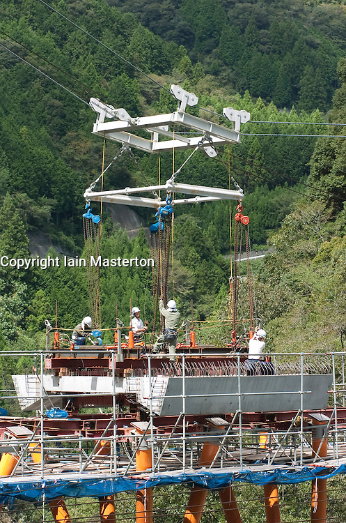 Erection of precast concrete deck units at Yamashiro Bridge in Shikoku Japan