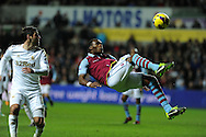 Aston Villa's Christian Benteke gets in an overhead kick. Barclays Premier league, Swansea city v Aston Villa at the Liberty Stadium in Swansea, South Wales on New Years Day, Tuesday 1st Jan 2013. pic by Andrew Orchard, Andrew Orchard sports photography,