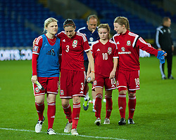 CARDIFF, WALES - Tuesday, August 21, 2014: Wales' Michelle Green, Nicola Cousins, Sarah Wiltshire and Hannah Keryakoplis look dejected after losing 4-0 to England during the FIFA Women's World Cup Canada 2015 Qualifying Group 6 match at the Cardiff City Stadium. (Pic by David Rawcliffe/Propaganda)