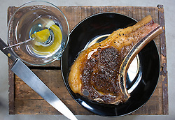 Seared Meat Hook Porterhouse Steak served with a Martini made with Bombay Sapphire Gin by James Moreland and Pickle by McClures Pickles.  Photograph by © Jackie Neale Chadwick