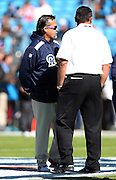 St. Louis Rams head coach Jeff Fisher talks to Carolina Panthers head coach Ron Rivera before the NFL week 7 football game against the Carolina Panthers on Sunday, Oct. 20, 2013 in Charlotte, N.C.. The Panthers won the game 30-15. ©Paul Anthony Spinelli