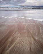 Patterend sand on Achnahaird beach caused by gentle washing of water down the gentle slope of the beach, sorting the sand by grain size and weight.