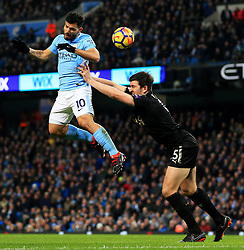 Sergio Aguero of Manchester City fires a header at goal under pressure from Harry Maguire of Leicester City - Mandatory by-line: Matt McNulty/JMP - 10/02/2018 - FOOTBALL - Etihad Stadium - Manchester, England - Manchester City v Leicester City - Premier League