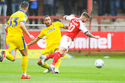 Rod McDonald of AFC Wimbledon (4) fouls Conor McAleny of Fleetwood Town (10) during the EFL Sky Bet League 1 match between Fleetwood Town and AFC Wimbledon at the Highbury Stadium, Fleetwood, England on 10 August 2019.
