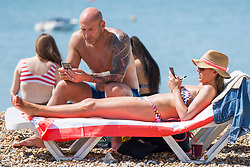 © Licensed to London News Pictures. 06/05/2018. Brighton, UK. Thousands of people take to the beach in Brighton and Hove on the May Bank Holiday Sunday as warm weather continues to hit the seaside resort. This weekend has been the hottest May Bank Holiday in the last 40 years. Photo credit: Hugo Michiels/LNP