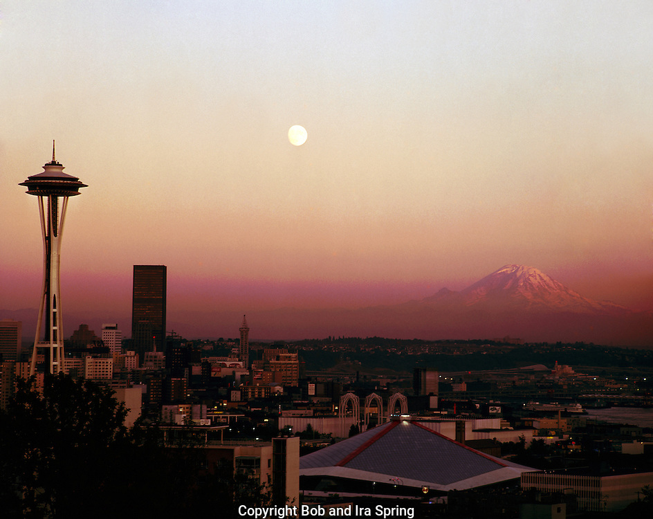 BI52,609-02...WASHINGTON - A 1969 photograph of the moon rising at sunset over Seattle and Mount Rainier in the distance.