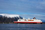 MS Richard With sailing into Herøyfjord, Norway | Hurtigruteskipet MS Richard With seiler inn i Herøyfjord, Norge. Flåvær i bakgrunnen.