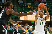 WACO, TX - DECEMBER 9: Lester Medford #11 of the Baylor Bears shoots a three-pointer against the Texas A&M Aggies on December 9, 2014 at the Ferrell Center in Waco, Texas.  (Photo by Cooper Neill/Getty Images) *** Local Caption *** Lester Medford