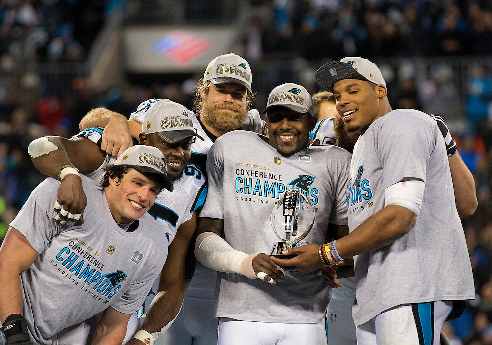 CHARLOTTE, NC - JAN 24:  Members of the Carolina Panthers (from left to right) including Luke Kuechly #59, Charles Johnson #95, Greg Olsen #88, Thomas Davis #58 and quarterback Cam Newton #1 celebrate during the trophy presentation after the NFC Championship game against the Arizona Cardinals at Bank of America Stadium on January 24, 2016 in Charlotte, North Carolina.