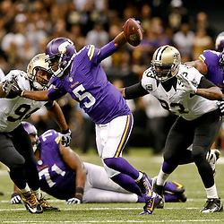Sep 21, 2014; New Orleans, LA, USA; Minnesota Vikings quarterback Teddy Bridgewater (5) is pressured by New Orleans Saints outside linebacker Junior Galette (93) and defensive end Cameron Jordan (94) during the second half of a game at Mercedes-Benz Superdome. The Saints defeated the Vikings 20-9. Mandatory Credit: Derick E. Hingle-USA TODAY Sports