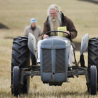 Farmer driving a vintage tractor  at vintage ploughing competition Perthshire 2005<br />