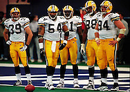 A stunned Packer defense waits on the goal line as the Colts huddle. They were running out the clock before kicking a field goal to win the game. WSJ/Apps.
