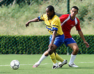 (L) SOCCER PLAYER FROM BARBADOS & (R) SOCCER PLAYER FROM COSTA RICA DURING FOOTBALL COMPETITION AT THE SPECIAL OLYMPICS WORLD SUMMER GAMES SHANGHAI 2007..SPECIAL OLYMPICS IS AN INTERNATIONAL ORGANIZATION DEDICATED TO EMPOWERING INDIVIDUALS WITH INTELLECTUAL DISABILITIES..SHANGHAI , CHINA , OCTOBER 06, 2007.( PHOTO BY ADAM NURKIEWICZ / MEDIASPORT )..