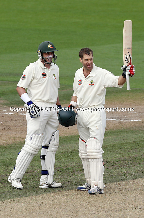Australian batsman Simon Katich celebrates his century during the second innings as Michael Hussey looks on.<br />