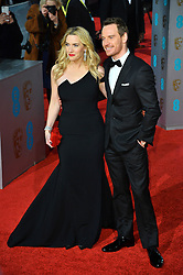 © Licensed to London News Pictures. 14/02/2016.  London, UK. KATE WINSLET and MICHAEL FASSBENDER arrives on the red carpet at the EE British Academy Film Awards 2016  Photo credit: Ray Tang/LNP