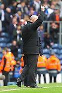 Picture by Paul Chesterton/Focus Images Ltd.  07904 640267.21/04/12.Blackburn Manager Steve Kean allows himself a little celebration at the end of the Barclays Premier League match at Ewood Park Stadium, Blackburn